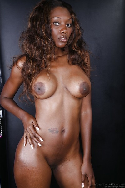 Seductive black pretty Nyomi Banxxx slipping off her pink sexy pants