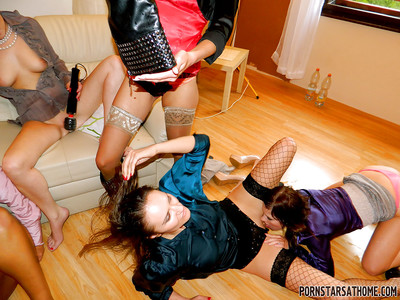 Lewd ladies full around a extreme partly dressed woman-on-woman group sex at the address munch