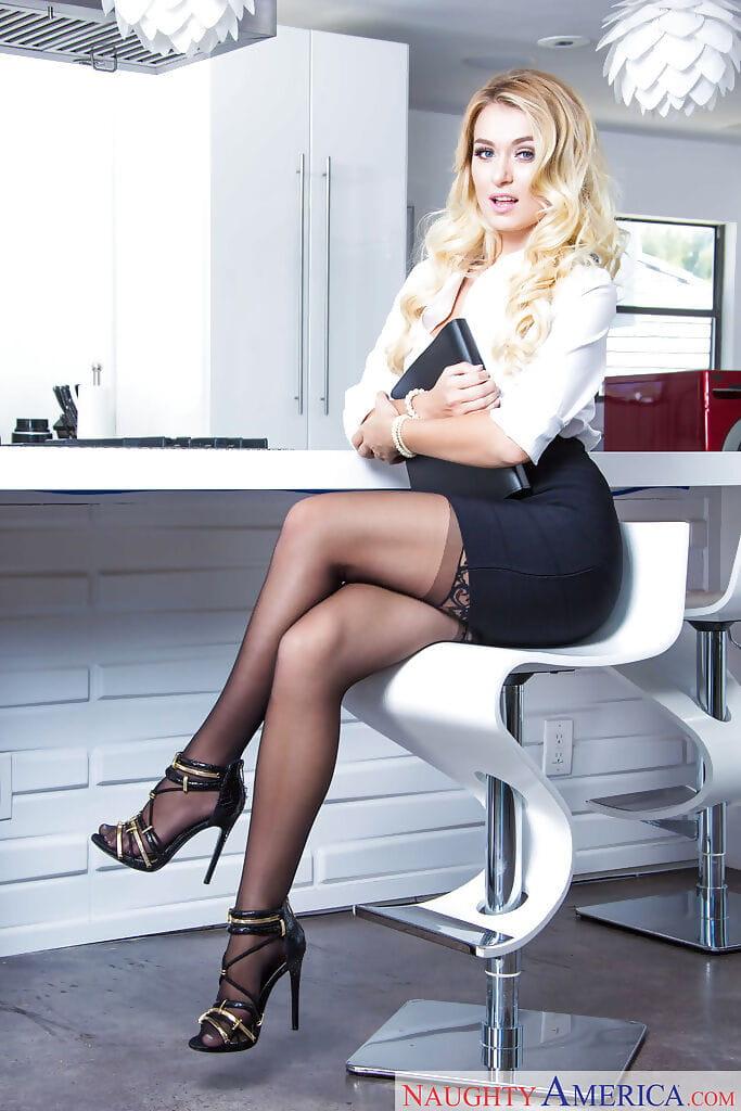 European pornstar Natalia Starr shedding miniskirt to display nylon clothing legs