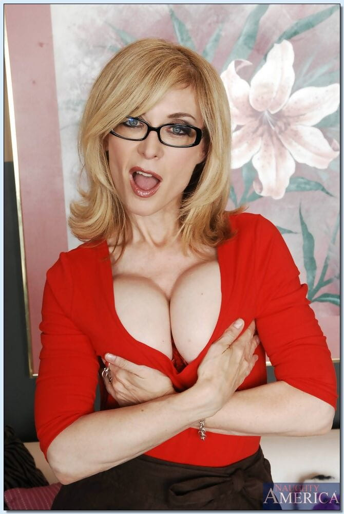 Sex-hungry placid lassie Nina Hartley revealing her jugs and inviting pussy