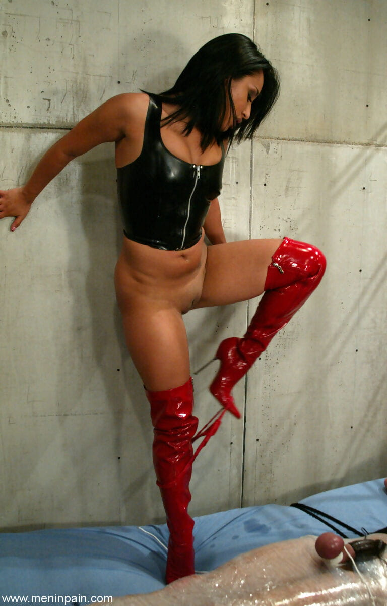 Tanned  Jasmine Byrne tortures attached up submissive in the cage