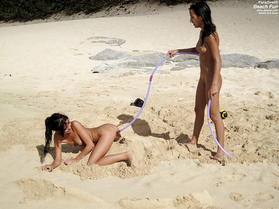 Seductive nineteen lesbian hotties erotic dancing and caressing every other on the beach