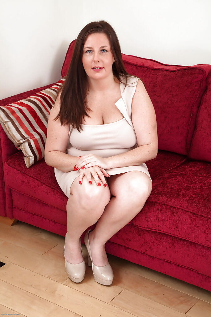 Fatty calm lassie with unshaven muff undressing and widening her legs