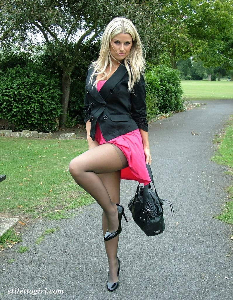 Covered fairy in pink petticoat showcases her nylon clothing legs in unproven high heels