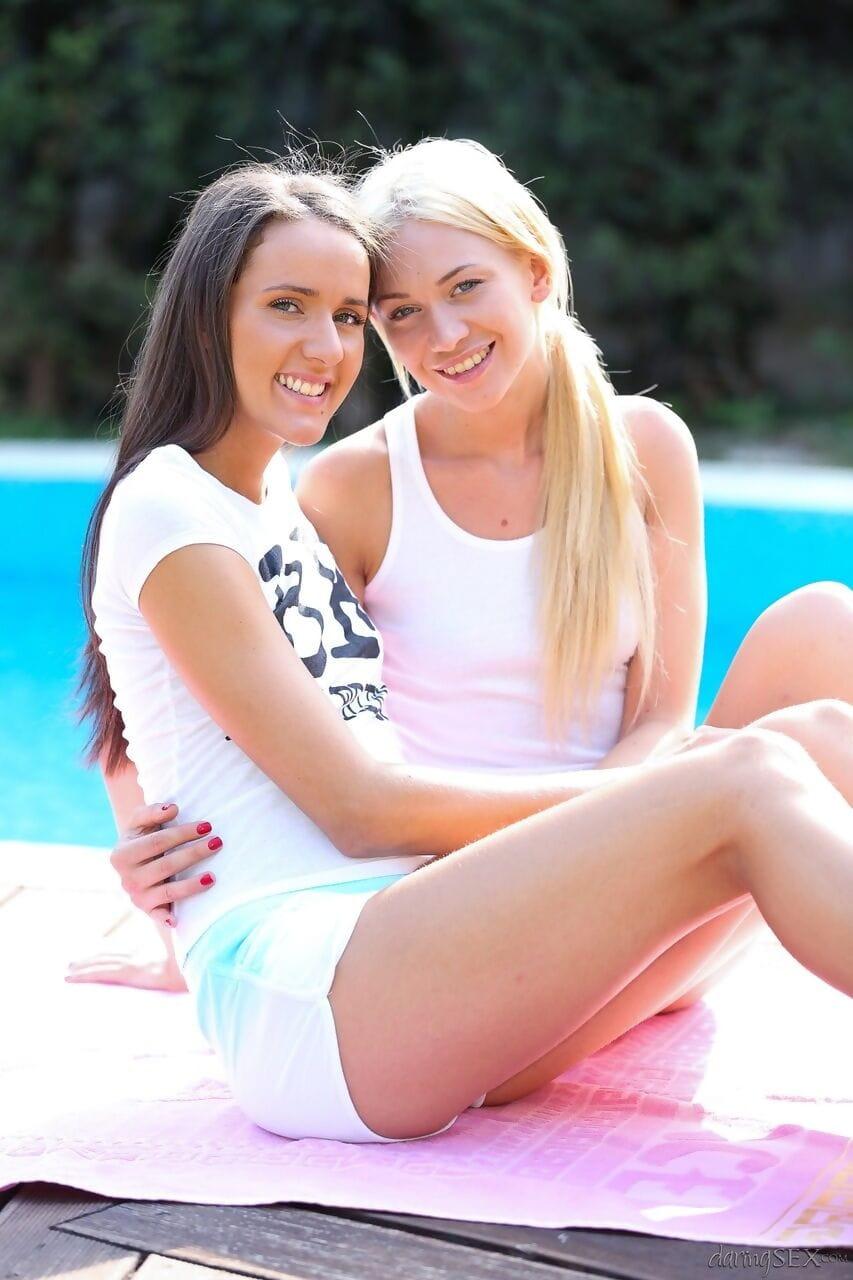 Teen Lindsey Olsen & Adriana Z strip off poolside to kiss petite pantoons & finger