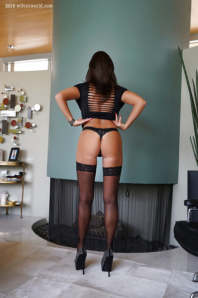 Grown housewife Sandra Otterson flaunting hooters and wazoo in strap strings