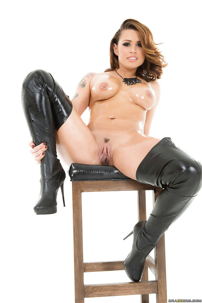 Tattooed Latin chico solo lass Eva Angelina oiling up enormous mounds and booty in boots