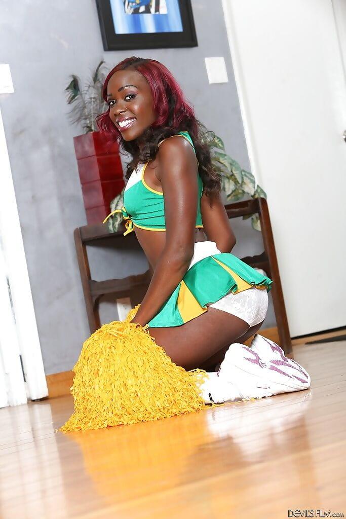 Black-skinned cheerleader Bella Cutie is dancing as was born on the web camera