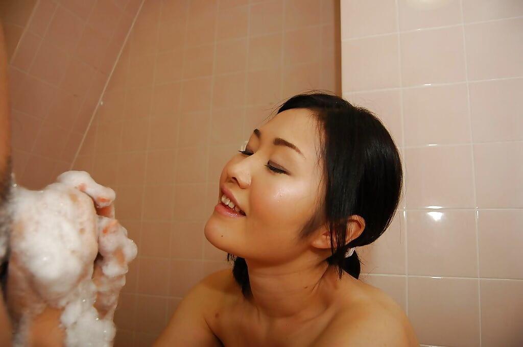 Appealing looking Japanese princess Megumu washing pecker and giving a hand job