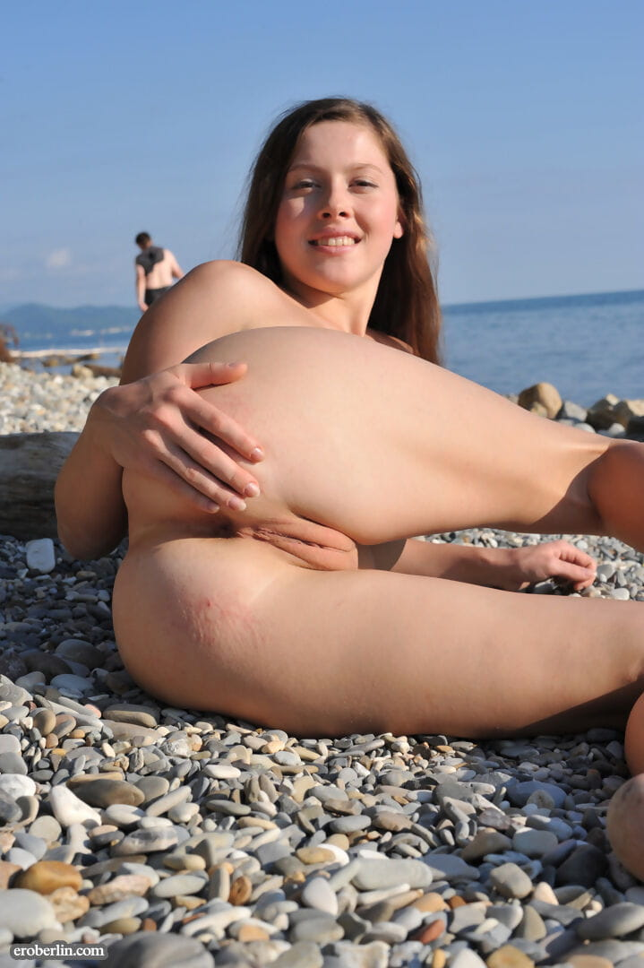 Solo princess shows her skinhead twat on a beach in the Ukraine