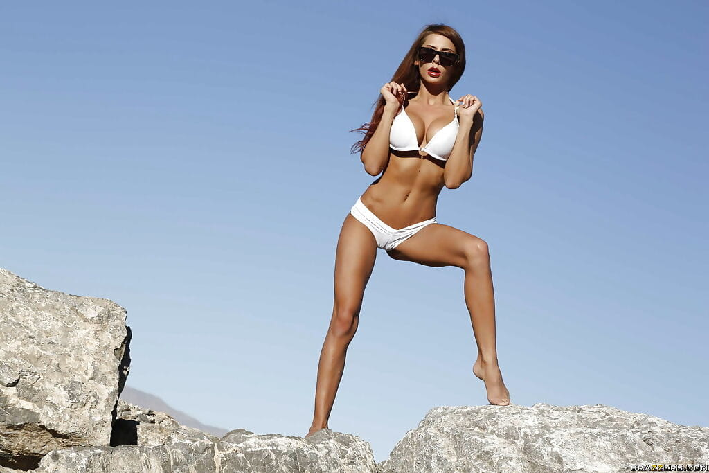 Rounded centerfold case Madison Ivy posing outdoors in bikini and sunglasses