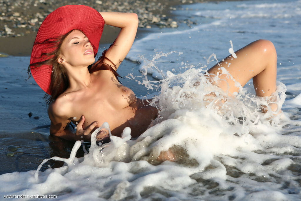 Completely exposed angel Galina A strikes wonderful ocean participate positions in a red sun hat