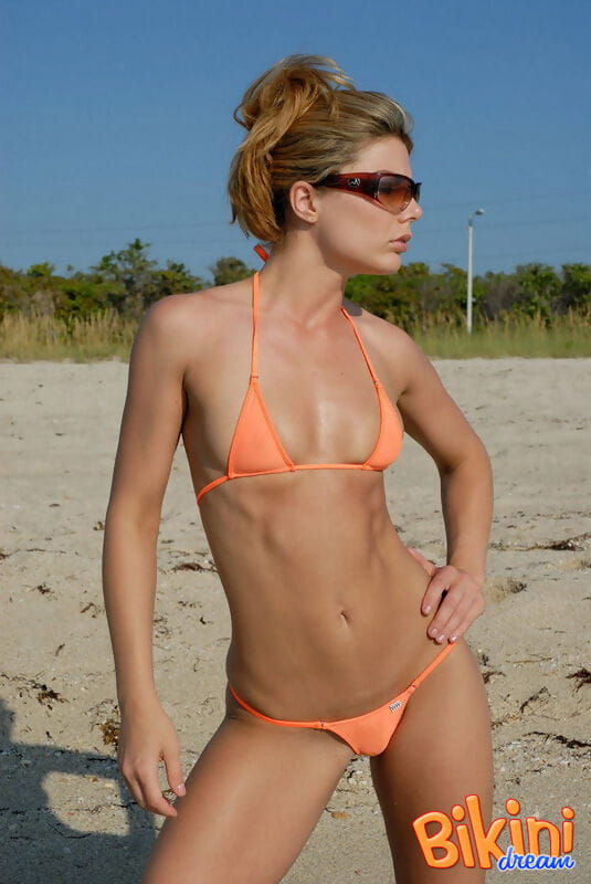 Sweaty beach hotty Amber in skimpy bikini location on her knees in the sand