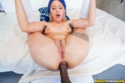 Tattooed fairy darling benefits from her holes fucked by a gigantic ebony dick