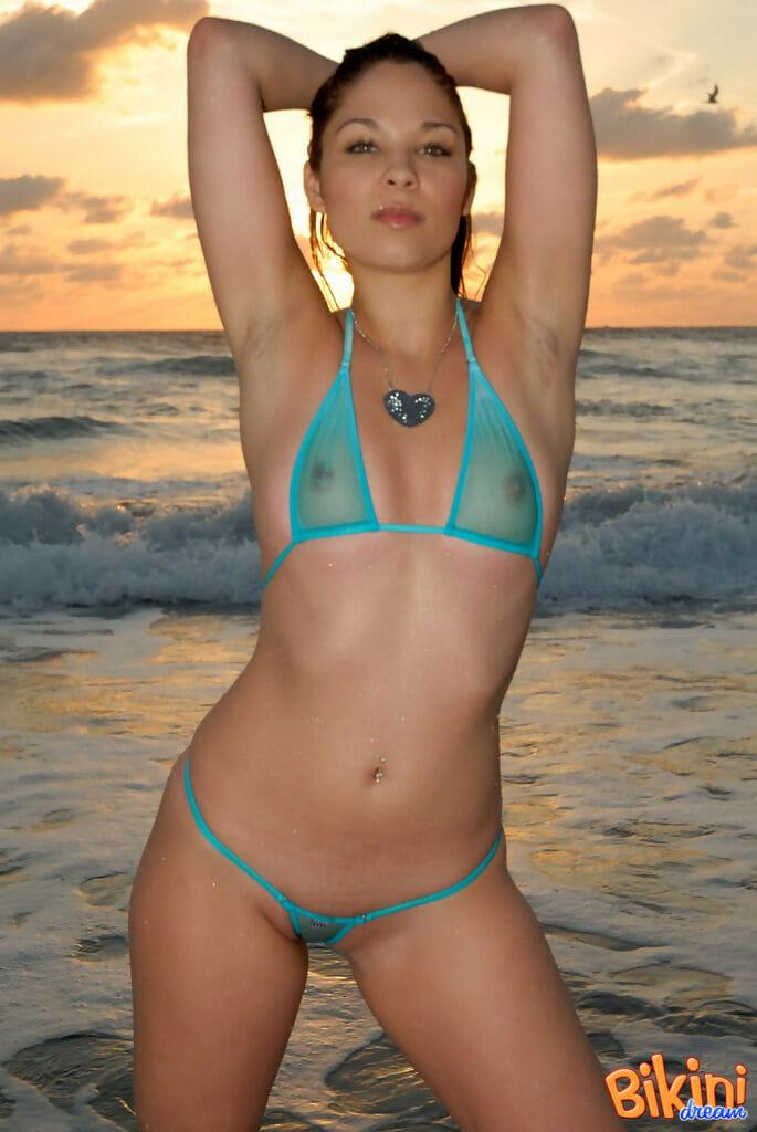 Solo hottie Ali beauties at the beach wearing a perceive thru bikini