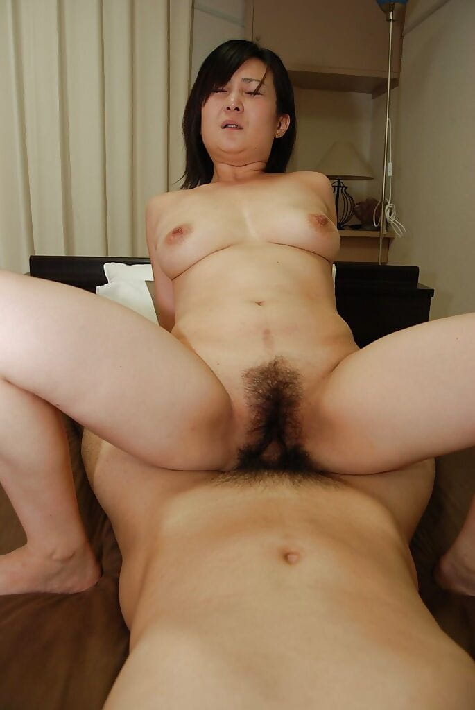 Raunchy japanese MILF gives a titjob and acquires her curly wet crack boned-up