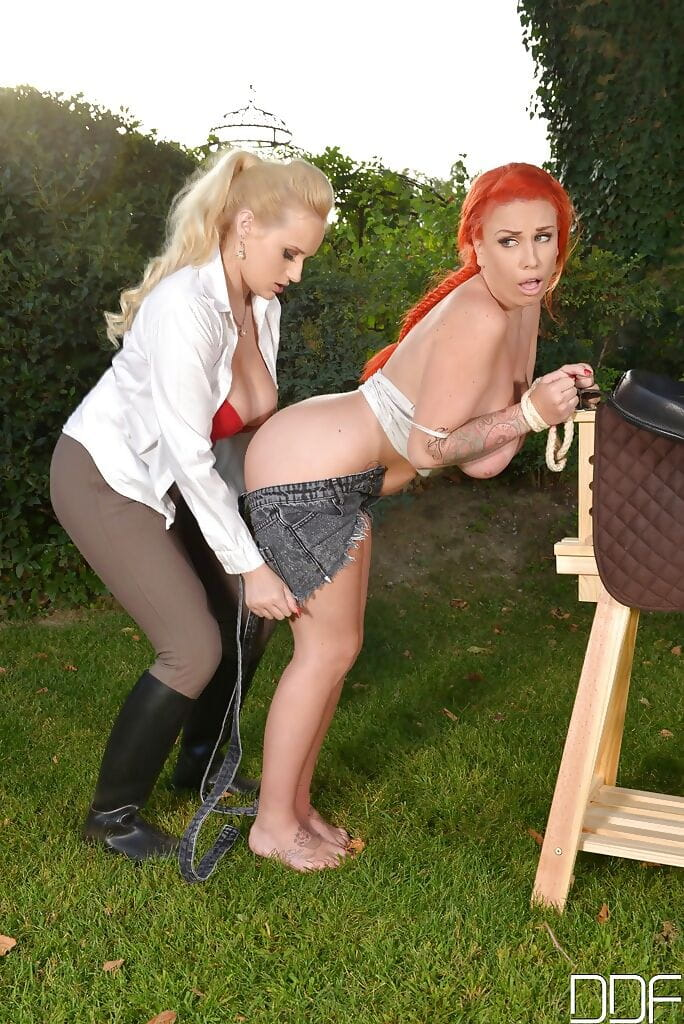 LiLy Madison and blond Darling Wicky digs in Bondage style outdoors
