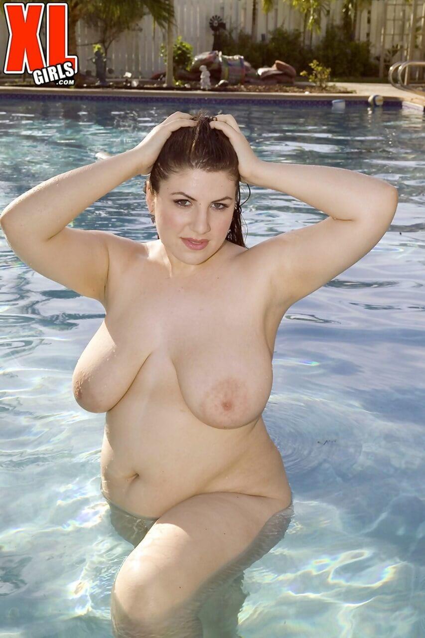 Fair skinned BBW Jane Hit takes off her skimpy bikini although poolside take part in