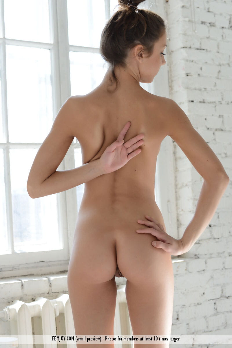 Elegant youthful Medina U kneel on a chair as was born and flaunts her mini hot apple bottoms