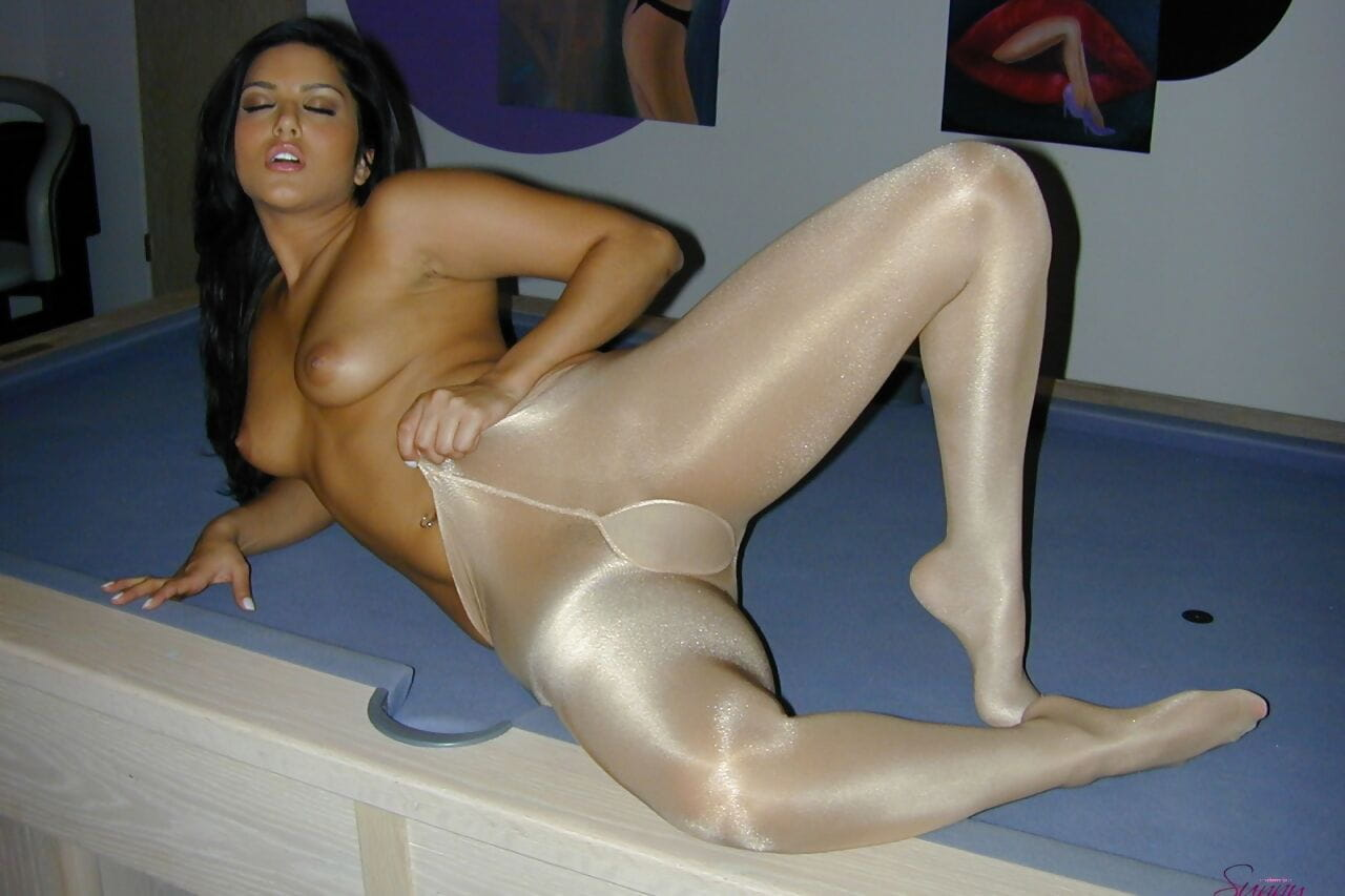 Damp Canadian playgirl Cute Leone goes topless in tights and ankle tie heels