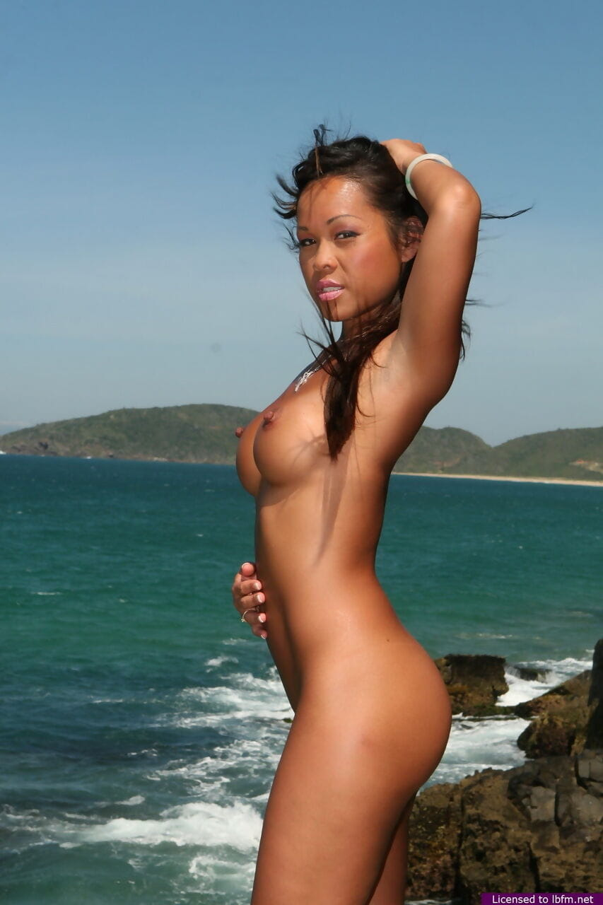 Oriental young makes her stripped modelling debut as the surf pounds the coast bottom