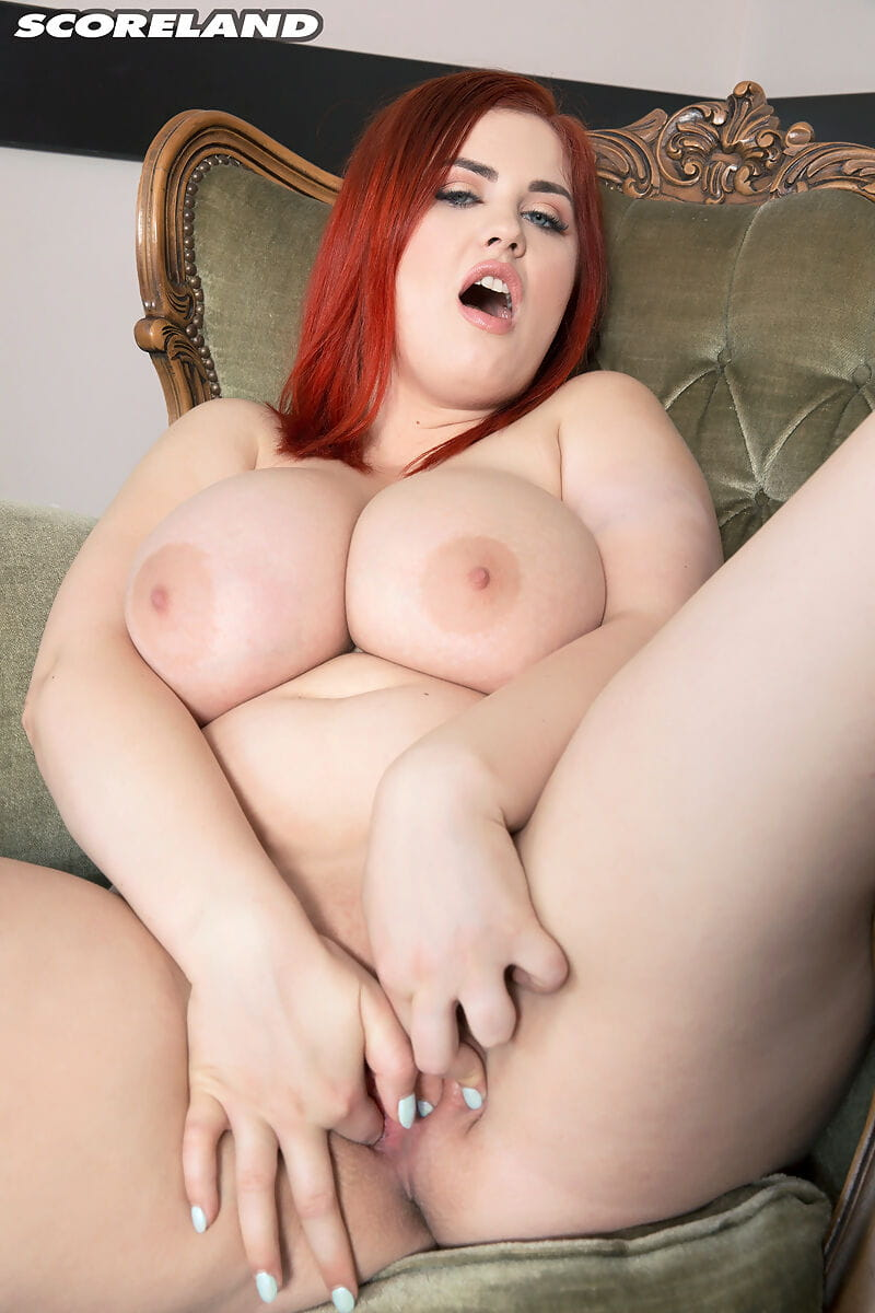Redhead Alexsis Faye shows her wonderfully large mangos & finger sleeps with on a chair