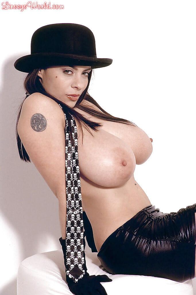 Hawt MILF Linsey Dawn McKenzie posing in micro-skirt and bowler hat