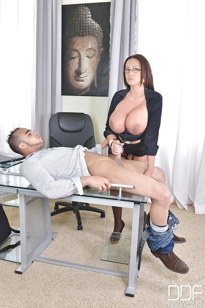 European big-tit secretary in glasses Emma Apple bottoms is engulfing a rod