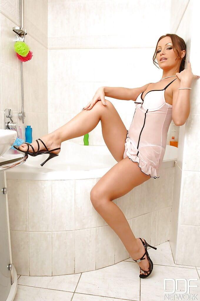 Foot infatuation scene in shower-room with a desire legged girl Maya in high heels
