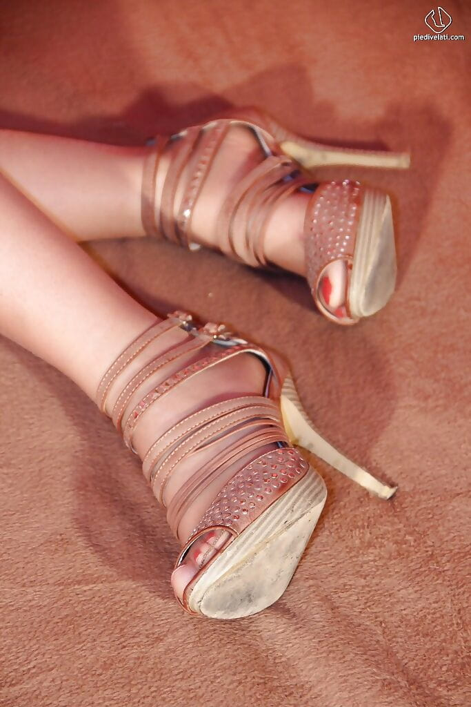 Golden-haired lass with incredible face and legs Christelle in foot fixation view