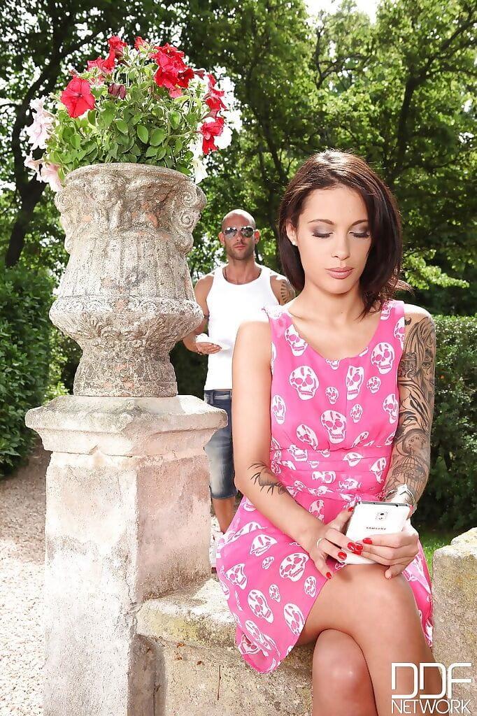 Brown hair milf Nikita Bellucci is showing off outdoor in her pink suit