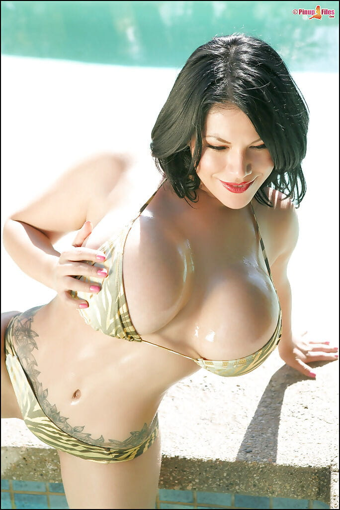 Darksome haired angel Ana Rica freeing enormous knockers from bikini outdoors
