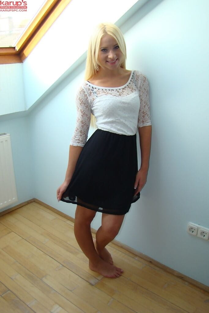 Golden-haired teenager takes off her petticoat and clothing to leach her smooth muff