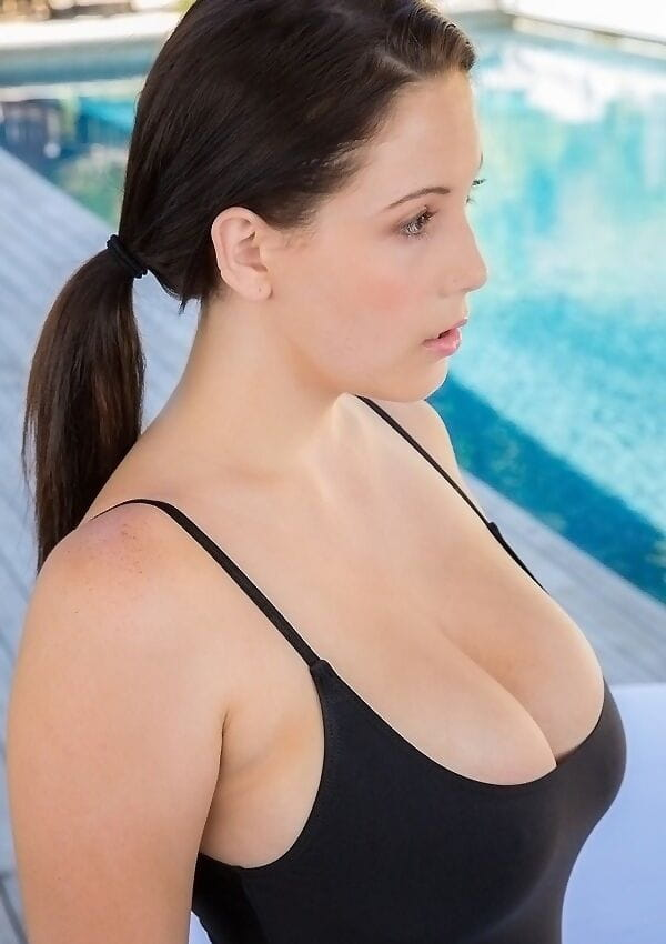 Attractive brown hair lass in swimsuit revealing her sweet tough jugs