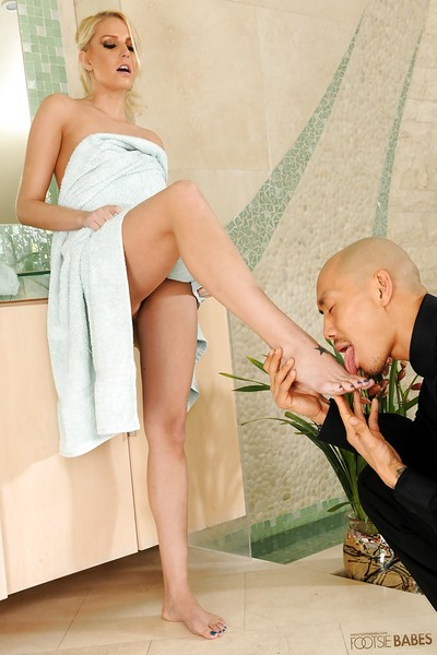 Svelte fairy-haired Vanessa Cage receives her toes licked and gives a footjob