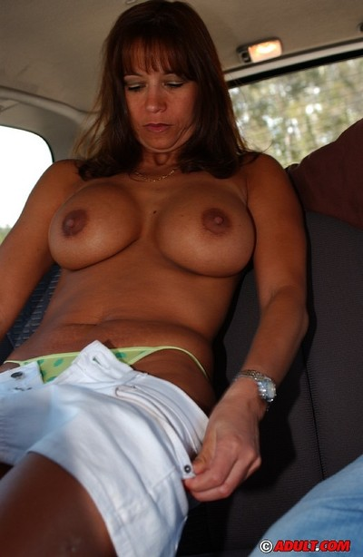 Perky cougar with round jugs shows off her fellatio skills in the car