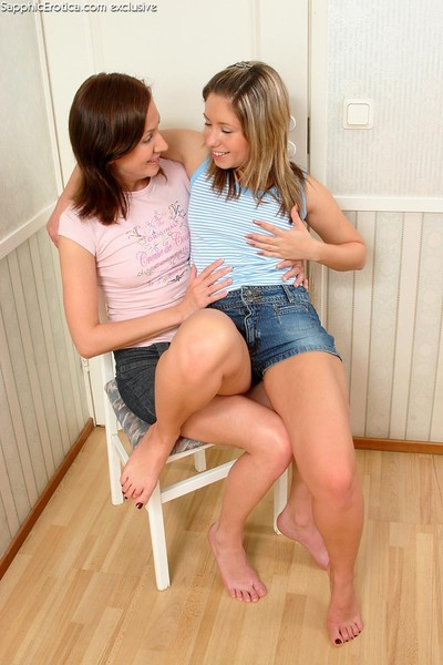 Youthful chicks tenderly take up with the tongue play with tongue and plug drenched slits
