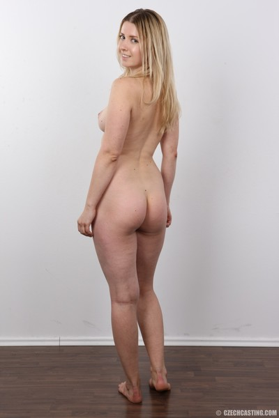 Gorgeous youthful lass standing nude