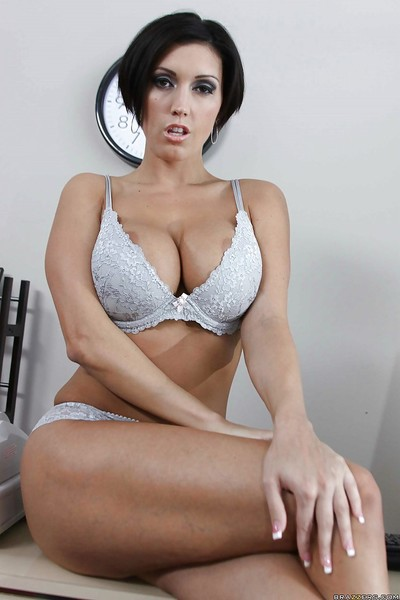 Lusty office MILF Dylan Ryder with massive meatballs is touching her snatch