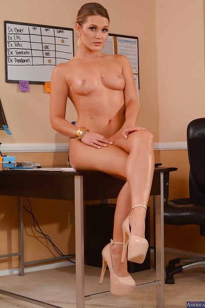 Office dear Abby Cross positions in a extreme sexy pants and high heels