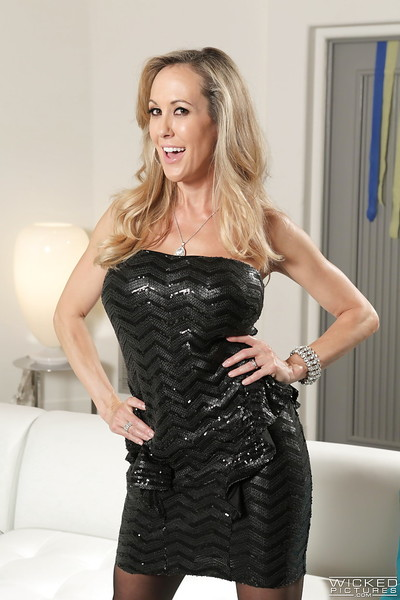 Milf blond Brandi Love is posing and playing with her damp cage of love