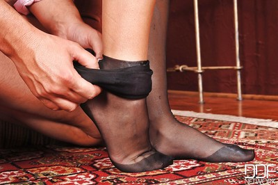 Dark brown cutie Eloa Lombard uses her nylon attired feet to play with dick ramrod