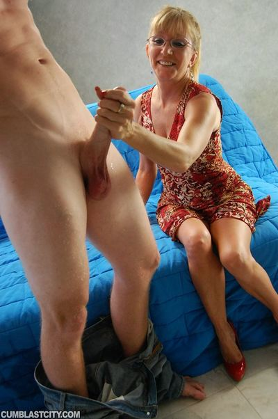 Seasoned lady in desire clothing gives a hand job and obtains bukkaked