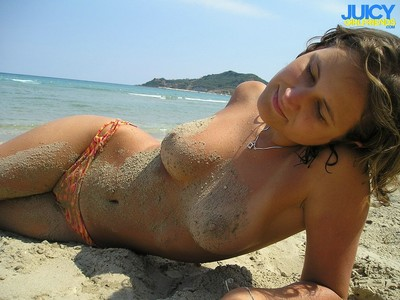 Spectacular youngster shows her admirable titties on public beach