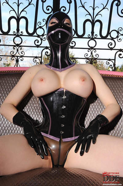 Curvy darling on high heels Lucy Latex posing in fixation outfit