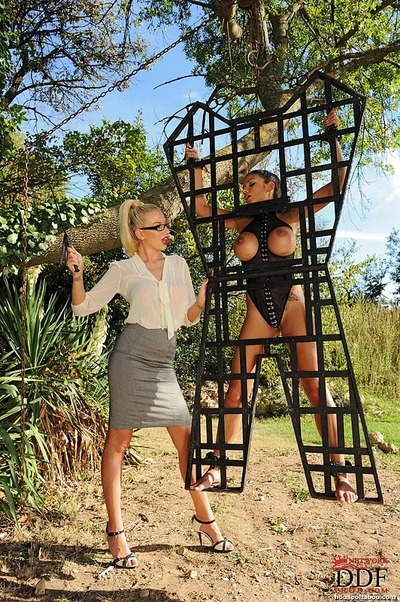 Strict MILF in glasses lashing and beating her curvy servant model
