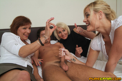 Unpracticed chicito is given a tugjob lesson by double MILFs using her companion