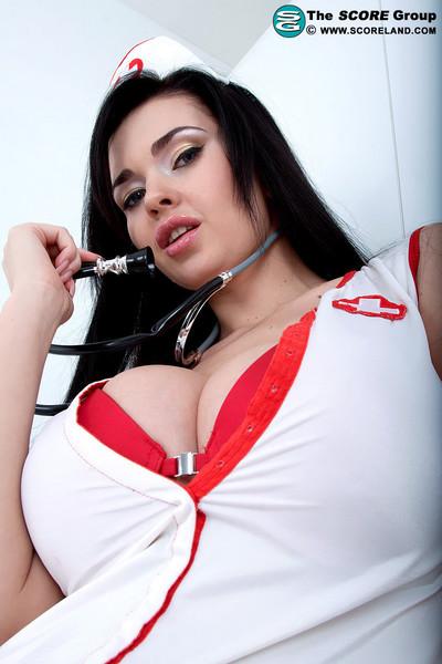 Moist nurse rubs her massive titties