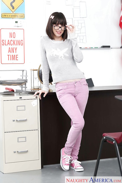 Glasses wearing coed Nora Beauty flashing diminutive melons in jeans and socks