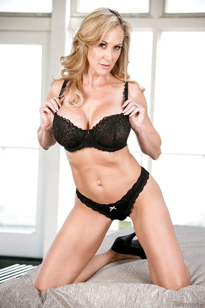 Perspired blond mommy Brandi Love showing of her well tattooed body